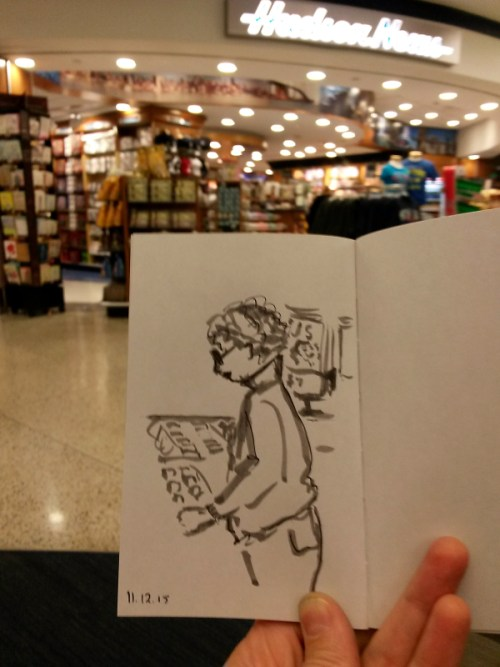 quick sketch of middle aged woman perusing an airport bookstore