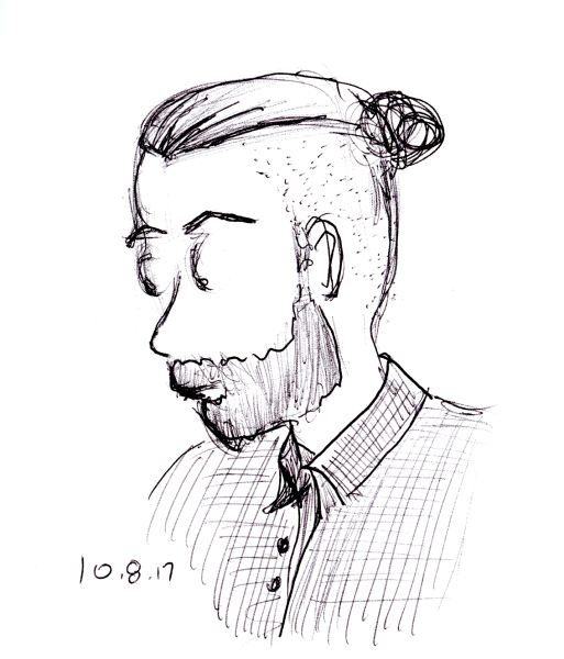 Quick ballpoint pen sketch of man with man bun hairstyle, by Joana Miranda