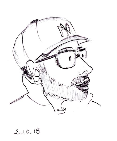 Quick ballpoint pen cartoon portrait sketch of man with Yankees baseball cap, by Joana Miranda
