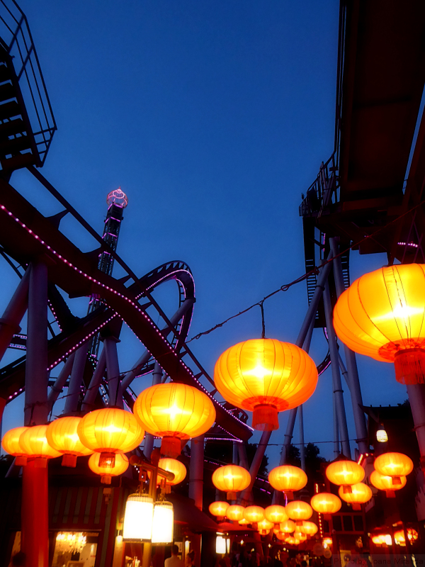 Red lanterns under roller coaster at Tivoli Gardens