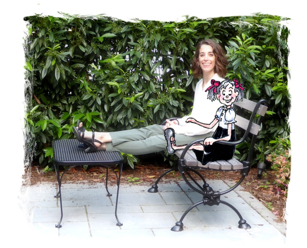 Photo of illustrator Joana Miranda seated on park bench with cartoon companion