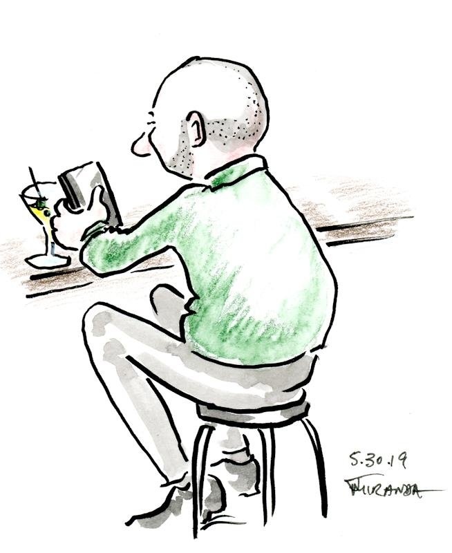 Quick-cartoon-illustration-sketch-of-man-seated-at-a-bar-by-Joana-Miranda