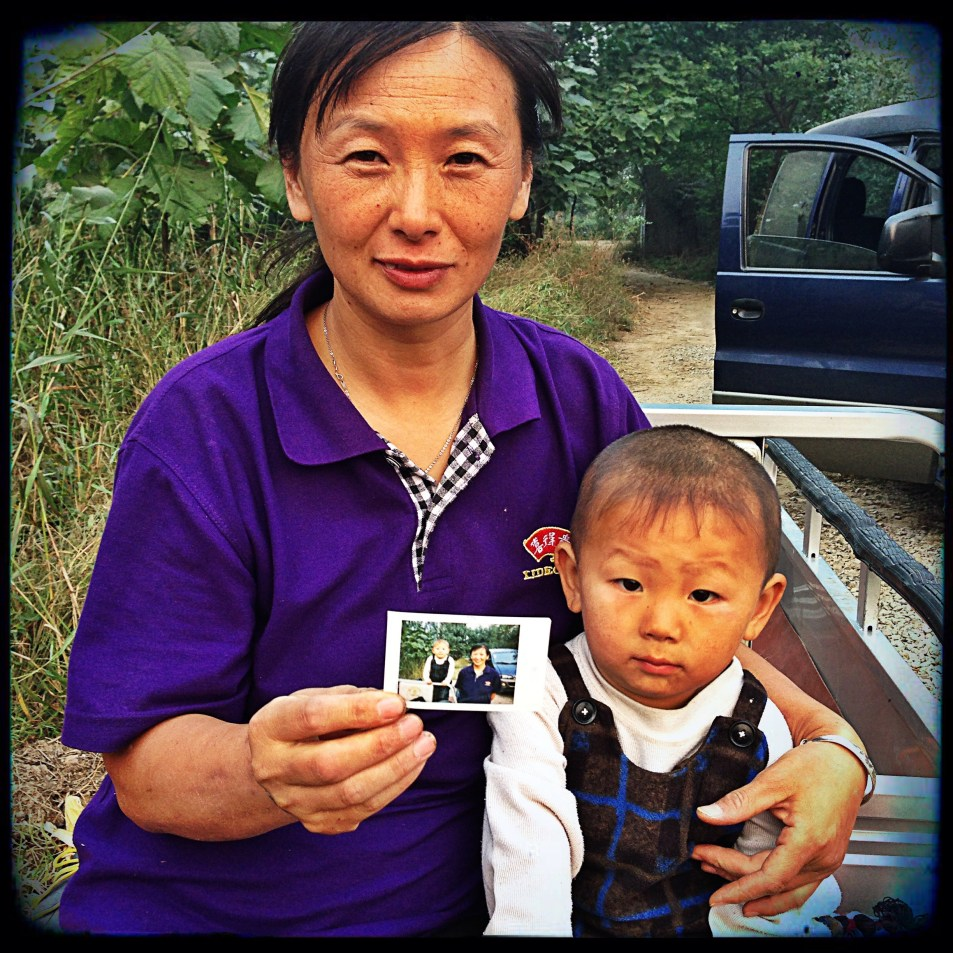 A cotton farmer and her son shot whilst filming in China for a CSR storytelling project