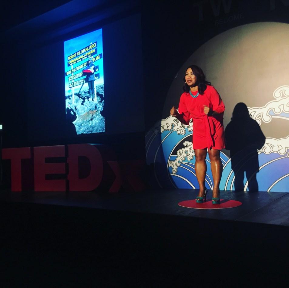 Liza Avelino on stage at Tedx TinHau Women