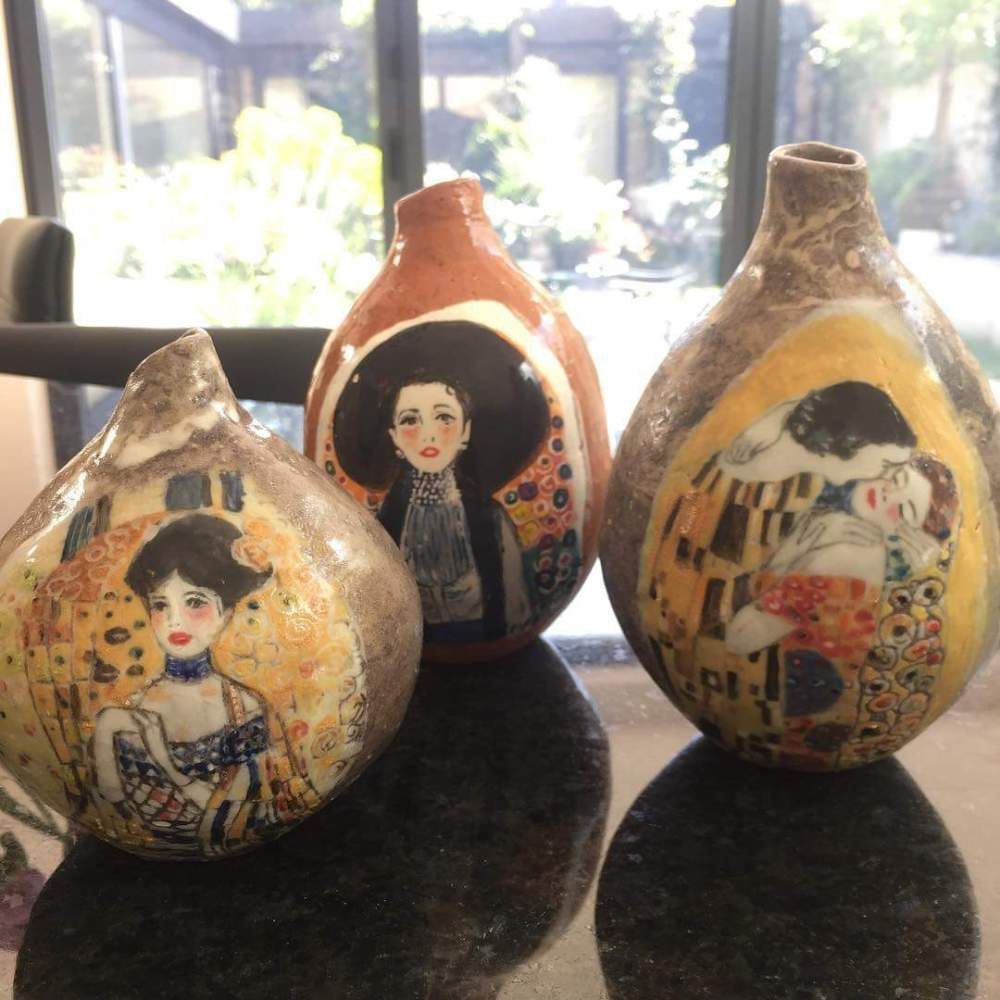 A trio of hand-built bud vases with Klimt-inspired painting styles, by Mary Funk