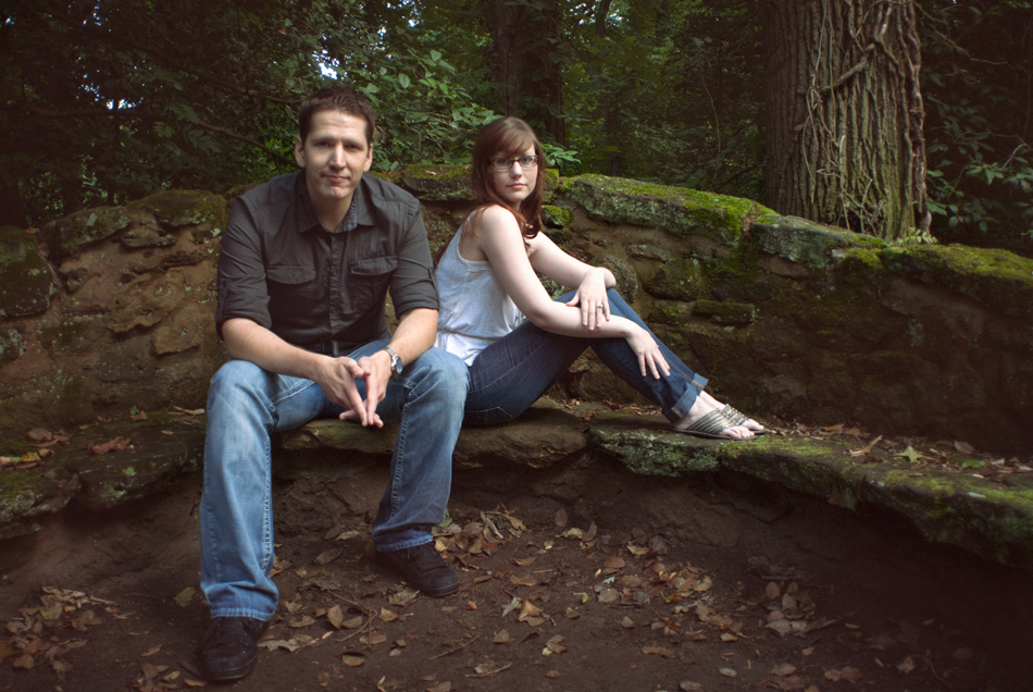 engagement picture with stone and moss