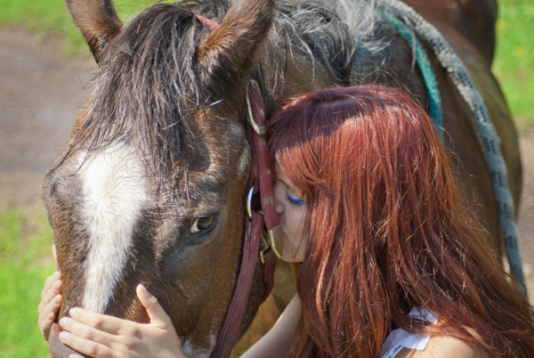 photo of girl kissing horse