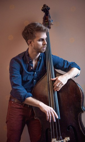 Photo of a musician playing an upright bass