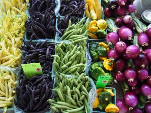 Organic yellow, purple and green beans at the farmer's market