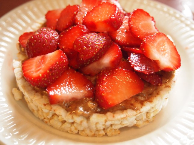 Who need Jam? Fresh strawberries with Almond Butter on a rice cake. Copyright Jo-Ann Blondin