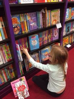 Charlotte choosing books April 2017a