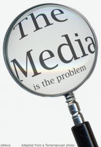 The Media is the problem. Magnifying Glass.