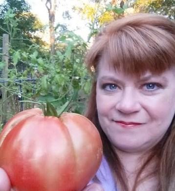 joann johnson holding a tomato