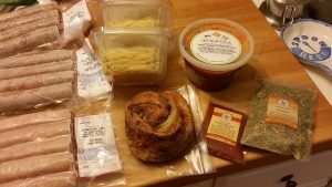 "Naked Pasta and sauce, Bake Room ""AM bun,"" The Spice & Tea Exchange of Greenville purchase and Fraylick Farm's pork links"
