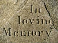stone that says in loving memory