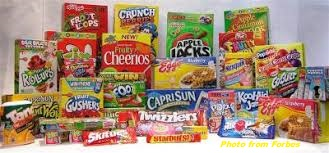 colorful cereal boxes and candy marketed for kids