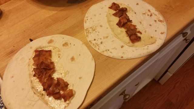 Place bacon and aioli on tortilla