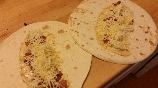 Leftover cheese applied to breakfast burritos