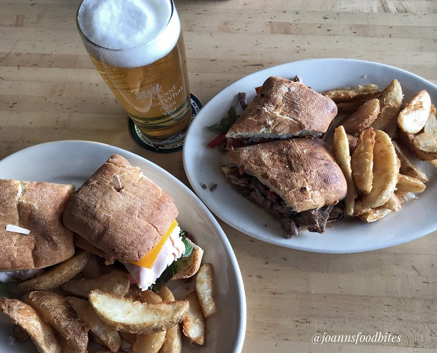 Turkey club and cheese steak sandwich from Squatter's Pub and Brewery