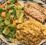 sea bass broccoli rice on a blue plate