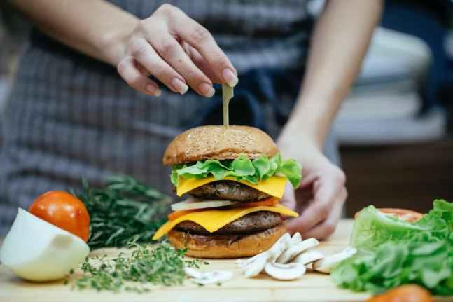 chef prepares a burger