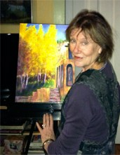 About Joan Pechanec: Image of artist Joan Pechanec at her easel