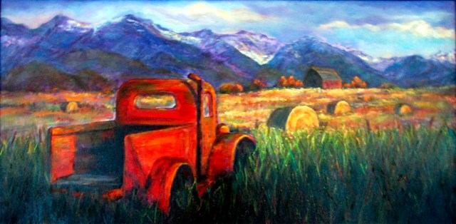 Image of a painting titled Montana Truck 12 x 24 oil on canvas depicting an old red truck in a field with purple Montana mountains in the background. Painting by Joan Pechanec