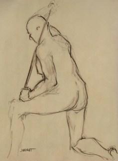 Kneeling male with walking stick