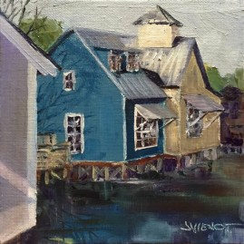 Oil painting of the bright little houses that are the Shops at Baytowne in Sandestin, FL, painted plein air from the bridge over the lake
