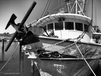 Photograph of the front of the fishing boat Lady Louise in Apalachicola, FL