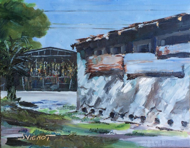 Oil painting of the light on the cracked stucco side of the Seafood building, with the wall of buoys across the street, downtown Apalachicola, FL