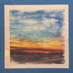Photo transfer, antiqued, of a color-saturated sunrise over the Choctawhatchee Bay