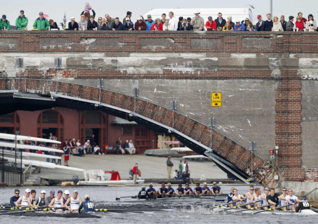 Teams from Georgetown University, left, Blue Cheese Rowing Club, center, and Grand Valley State University Rowing Club, right, compete in the men's alumni eights race during the Head of the Charles Regatta on the Charles River in Cambridge, Mass., Saturday, Oct. 22, 2011. (AP Photo/Michael Dwyer)