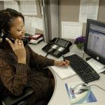 17341-an-african-american-woman-working-at-her-desk-pv1
