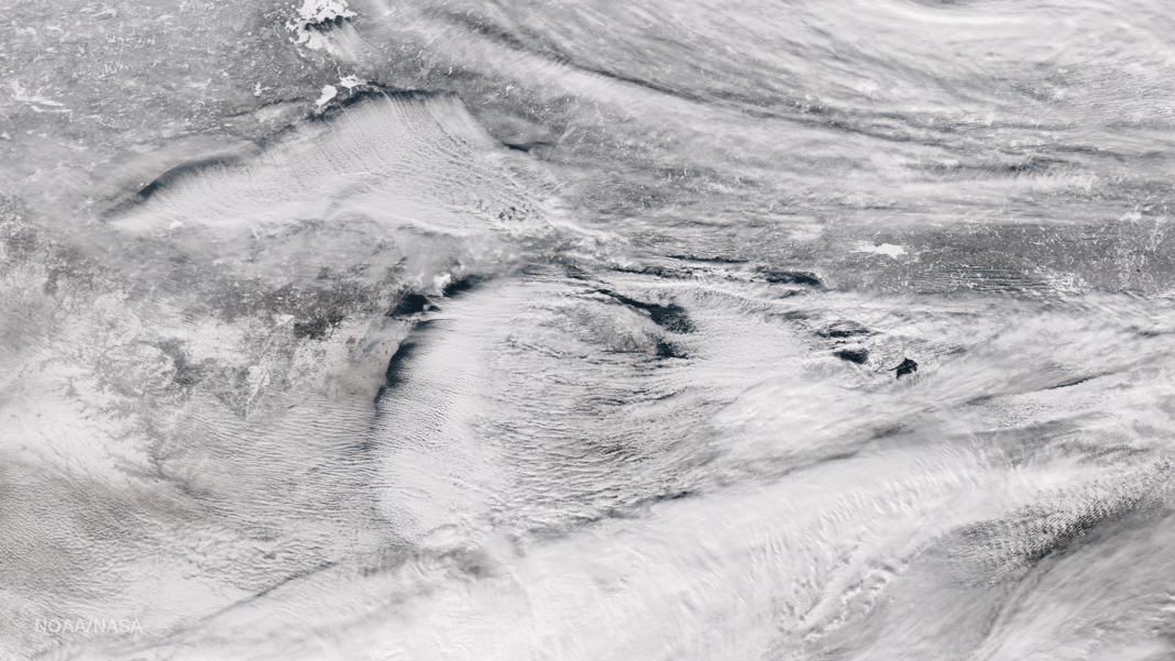 Bands of lake effect snow drift eastward from the western Great Lakes in this true-color image captured by the NOAA/NASA Suomi NPP satellite's Visible Infrared Imaging Radiometer Suite (VIIRS) instrument on January 5, 2017