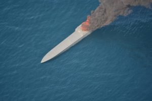A suspected smuggling vessel that went ablaze, as U.S. Coast Guard and Navy crews approached to intercept it, burns in international waters of the Eastern Pacific Ocean April 7, 2018. U.S. Customs and Border Protection photo
