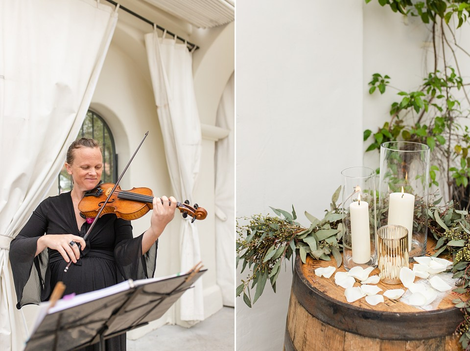 The violinist playing music smiling before the ceremony stated. A second photo of wine barrels with lit candles and flower petals near the altar