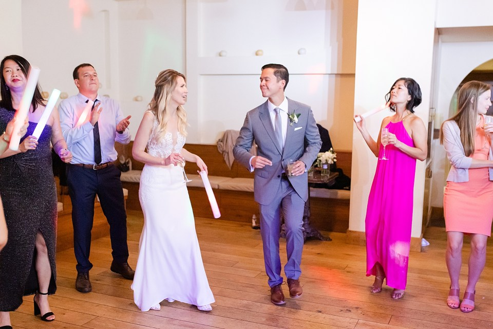 The bride and groom dancing the night away smiling and laughing with each other during their Villa & Vine Wedding