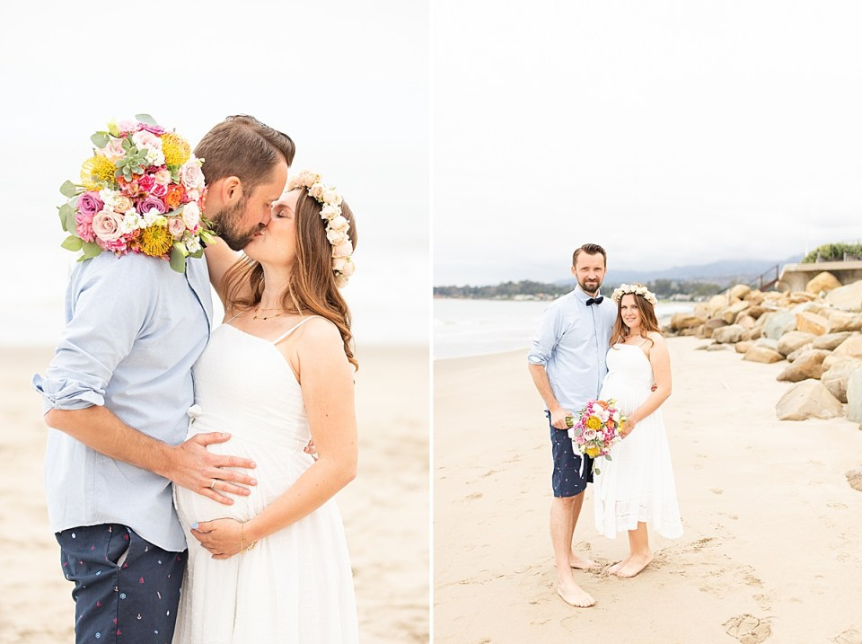 The couple sharing a kiss on the beach and smiling at the camera during their Santa Claus Beach Elopement
