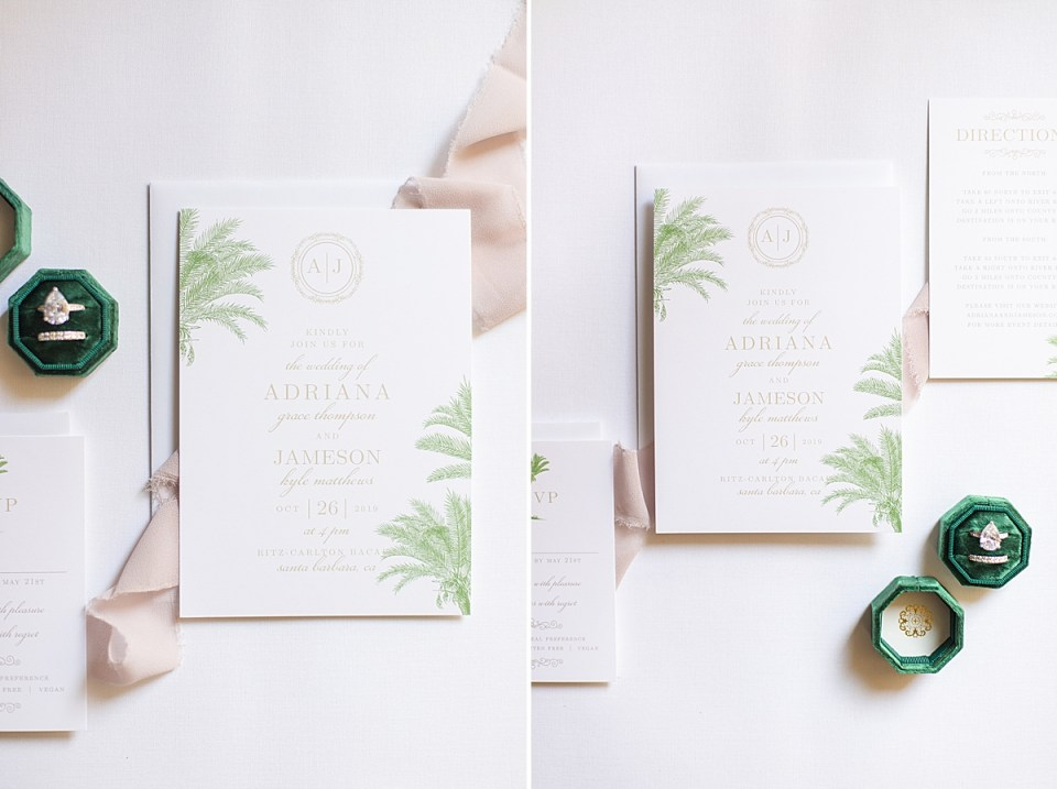 The couple's invitations and rings with pink lace scattered around.