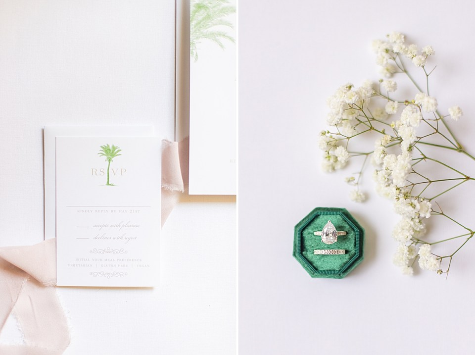 Emerald green ring box with rings and Baby's Breath florals.