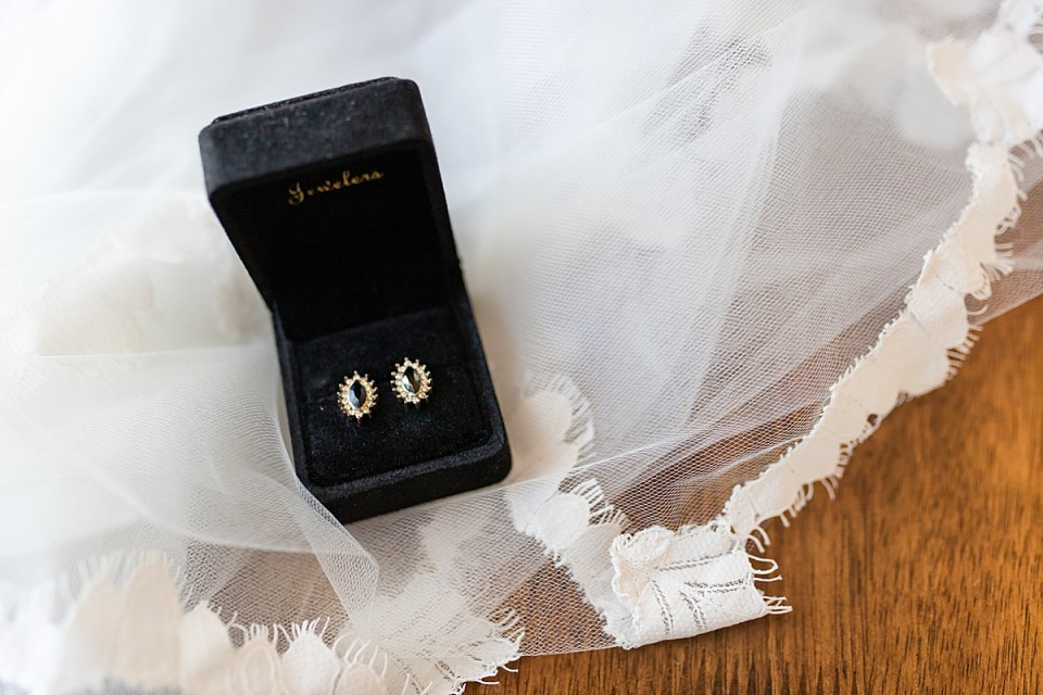 black and gold earrings passed down for generations to Brandi so she could wear them on her wedding day.