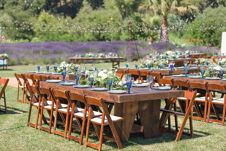 The reception tables with the lavender fields behind them and string lights above.