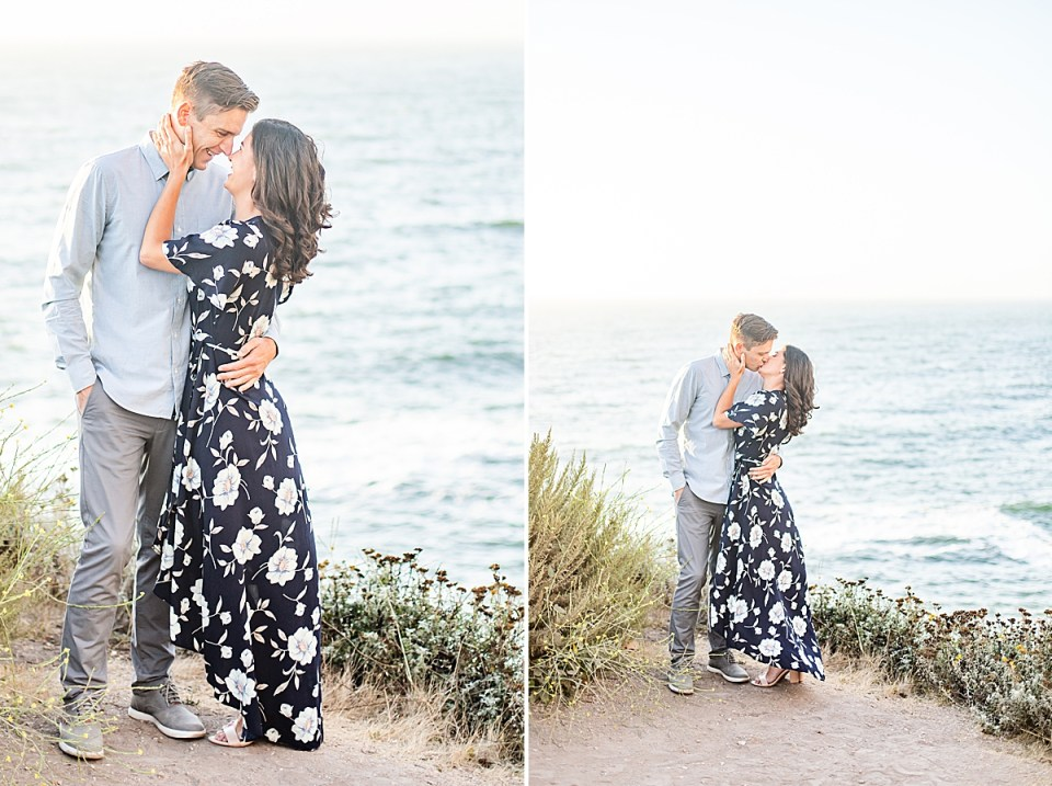 The couple is standing close together smiling at each other during their Montaña de Oro engagement session.