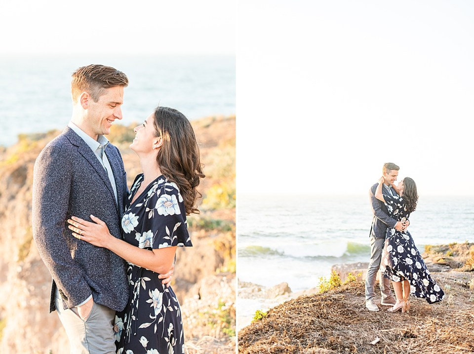 Scott is wearing a gray blazer and is pulling his bride in tightly. Lauren is smiling up at her fiancé and the ocean is in the background. A second image of the couple standing on the edge of the bluffs smiling at each other as Lauren's dress dances in the wind during their Montaña de Oro engagement session