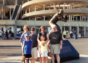Standing outside Kauffman Stadium with the George Brett statue. It has since been moved inside the stadium.