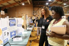 Kelley Johnson (left), Principal of Innovation Academy, discusses one of her school's project-based learning activities, Shark Tank, with Tinkia Ruffin (right), a math teacher at Selma Middle.