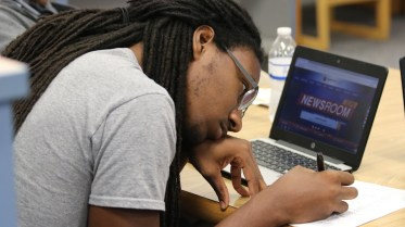 Clayton High student teacher and UNC Greensboro student Michael Mattocks completes a professional development exercise.