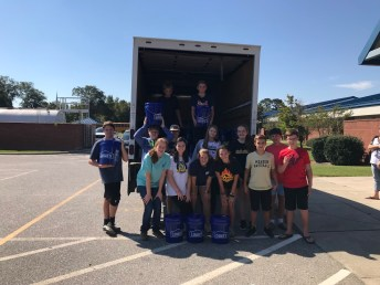 Meadow School Beta Club members load supplies for Hurricane Florence relief on Oct. 5. On the first row (from left) are Morgan Simpson, Laina Moore, Allison Stewart, Ashtyn Wade, Riley Adams, Tyler Beasley. On the second row (from left) are Lucas Thornton, Brendan Raynor, Carter Johnson, Jordyn Brown, Dara Kelly, Parker Denning. One the third row (from left) are Alex Lee and Dawson Anderson.