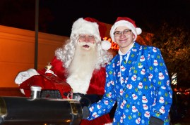 The highlight of the Benson Christmas Parade Friday night was the appearance of Santa Claus. Here he poses for a photo with helper Lance Stephenson. The parade wrapped up the evening monikered Christmas on Main.